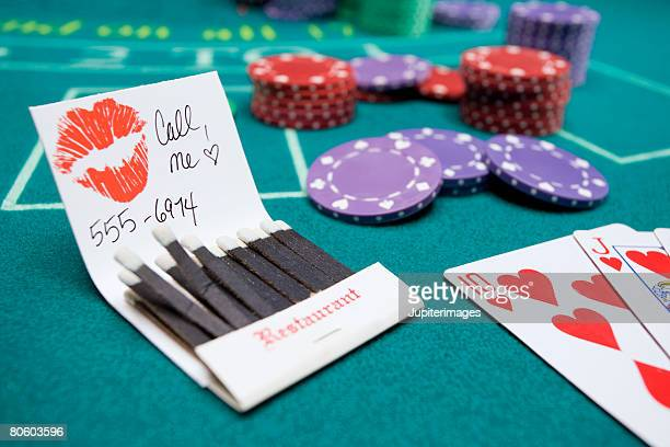 Matchbook with message and number on betting table
