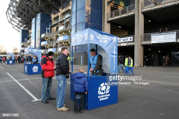 A matchday programme seller does business outside Murrayfield Stadium