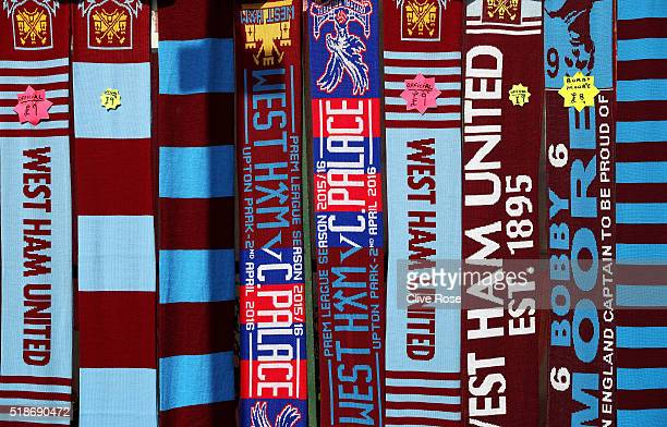 Matchday scarves are on sale prior to the Barclays Premier League match between West Ham United and Crystal Palace at the Boleyn Ground on April 2...