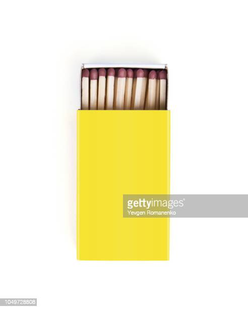 matches in yellow box isolated on white background - fiammifero foto e immagini stock