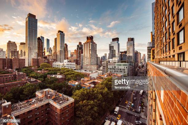 matching day & night new york skyline - new york city stock pictures, royalty-free photos & images