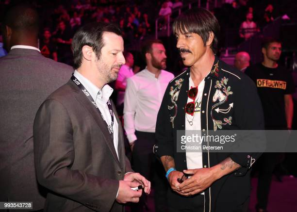 Matchmaker Sean Shelby talks with musician Anthony Kiedis during the UFC 226 event inside TMobile Arena on July 7 2018 in Las Vegas Nevada