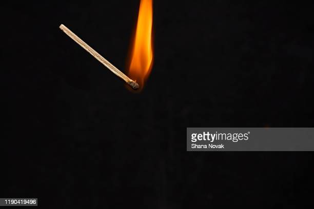 "matchstick on fire - ""shana novak"" stock pictures, royalty-free photos & images"