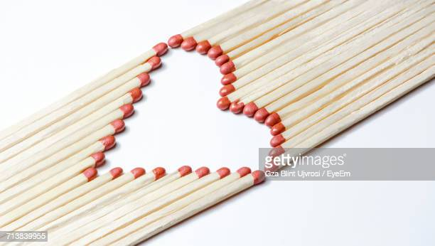 Matchsticks Forming Heart Shape On White Background