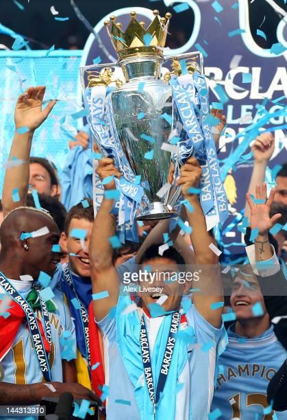 Matchwinning goalscorer Sergio Aguero of Manchester City lifts the trophy following the Barclays Premier League match between Manchester City and...