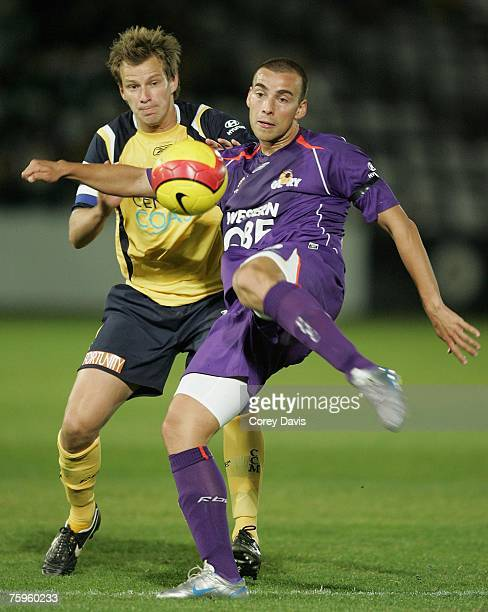 Mate Dragicevic of the Glory looks to pass ahead of Alex Wilkinson of the Mariners during the A-League pre-season cup semi final match between the...