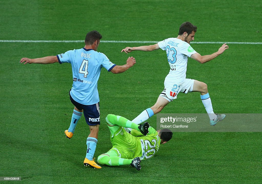 Mate Dugandzic of Melbourne City has his shot blocked by Sydney FC goalkeeper Vedran Janjetovic during the round seven A-League match between Melbourne City and Sydney FC at AAMI Park on November 22, 2014 in Melbourne, Australia.