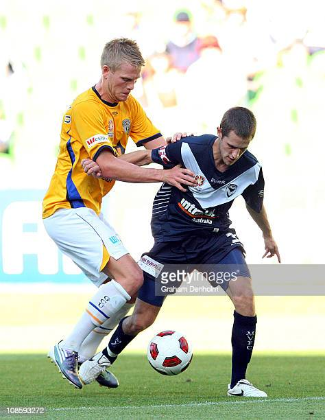 Mate Dugandzic of the Victory controls the ball under pressure during the round 25 ALeague match between the Melbourne Victory and Gold Coast United...