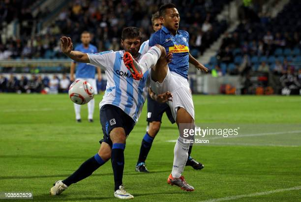 Mate Ghivinianidze of Muenchen challenges Chong Tese of Bochum during the Second Bundesliga match between VfL Bochum and TSV 1860 Muenchen at...