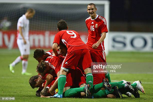 Mate Kiss of Hungary is mobbed by his team mates after scoring the opening goal of the FIFA U20 World Cup Round of Sixteen match between Hungary and...