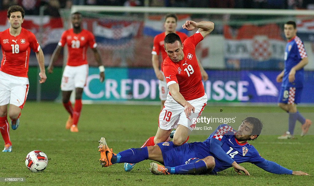 Mate Males of Croatia (R) challenges Josip Drmic of Switzerland (L) during the international friendly match between Switzerland and Croatia at the AFG Arena on March 5, 2014 in St Gallen, Switzerland.