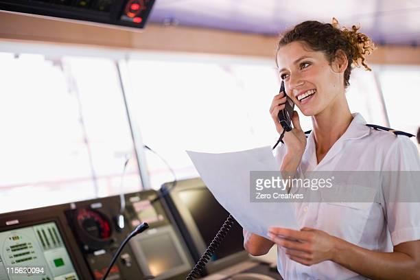 Mate of a ship doing a phone call