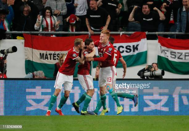 Mate Patkai of Hungary celebrates with teammates Roland Varga and Zsolt Kalmar after scoring the second goal of his team during the 2020 UEFA...