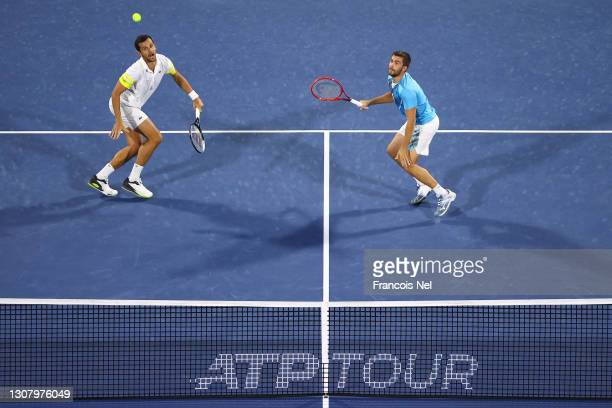 Mate Pavic and Nikola Mektic of Croatia in action during their Men's Doubles Semi Final match against Ivan Dodig of Croatia and Filip Polasek of...