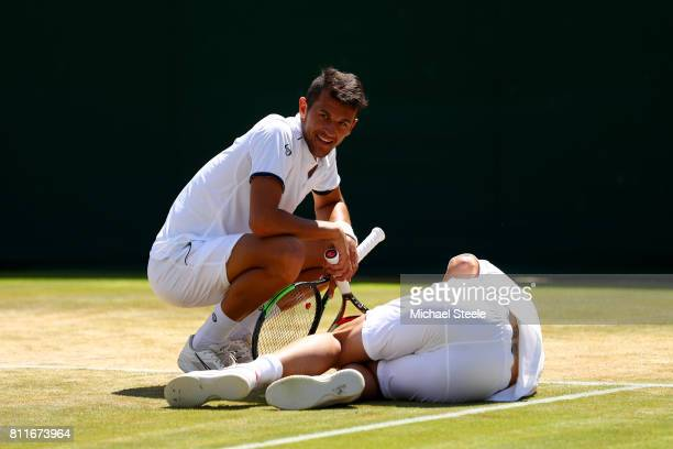 Mate Pavic of Croatia alongside injured partner Oliver Marach of Austria during the Gentlemen's Doubles third round match against Jay Clarke of Great...