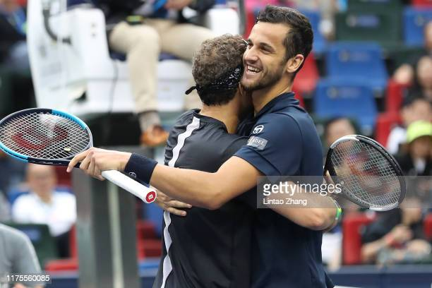 Mate Pavic of Croatia and Bruno Soares of Brazil celebrate after winning the Men's doubles final match against Lukasz Kubot of Poland and Marcelo...