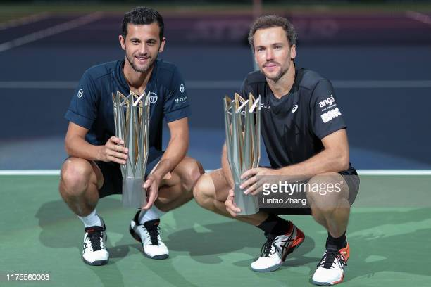Mate Pavic of Croatia and Bruno Soares of Brazil celebrate with trophy during the Award Ceremony after winning the Men's doubles final match against...