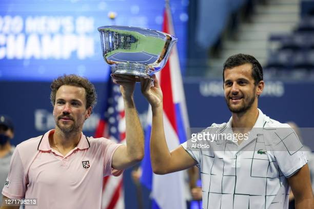 Mate Pavic of Croatia and Bruno Soares of Brazil celebrate with the trophy after winning their Men's Doubles final match against Wesley Koolhof of...