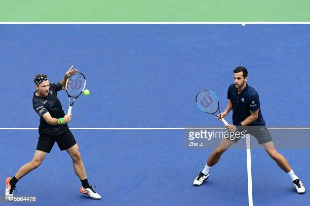 Mate Pavic of Croatia and Bruno Soares of Brazil in action during the Men's doubles final match against Lukasz Kubot of Poland and Marcelo Melo of...