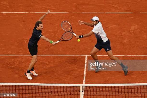 Mate Pavic of Croatia and Bruno Soares of Brazil play in their Men's Doubles Final on Court Philippe-Chatrier against Kevin Krawietz and Andreas Mies...