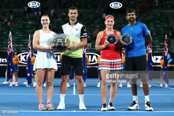 Mate Pavic of Croatia and Gabriela Dabrowski of Canada pose for a photo with the championship trophy after winning the mixed doubles final Timea...