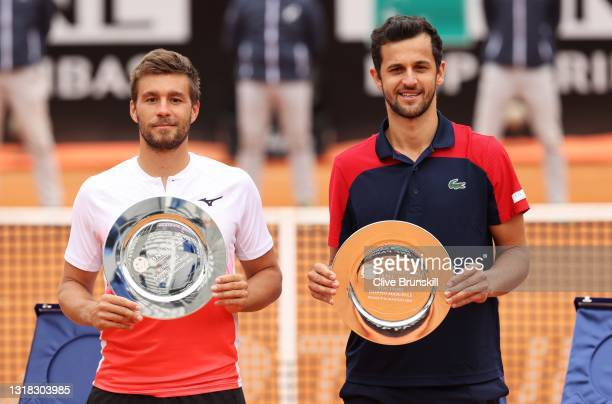 Mate Pavic of Croatia and Nikola Mektic of Croatia celebrate victoryand pose with the winners plates after men's doubles final against Rajeev Ram of...
