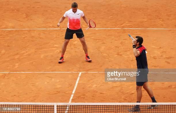 Mate Pavic of Croatia and Nikola Mektic of Croatia celebrate victory in the men's doubles final against Rajeev Ram of the USA and Joe Salisbury of...