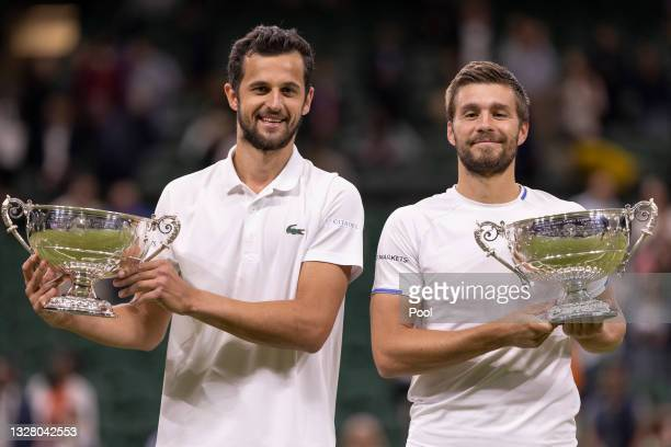 Mate Pavic of Croatia and Nikola Mektic of Croatia celebrate with their trophies after winning their Men's Doubles Final match against Marcel...