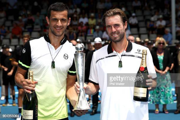 Mate Pavic of Croatia and Oliver Marach of Austria pose with the trophy following their Mens Doubles Final against Philipp Oswald of Austria and Max...