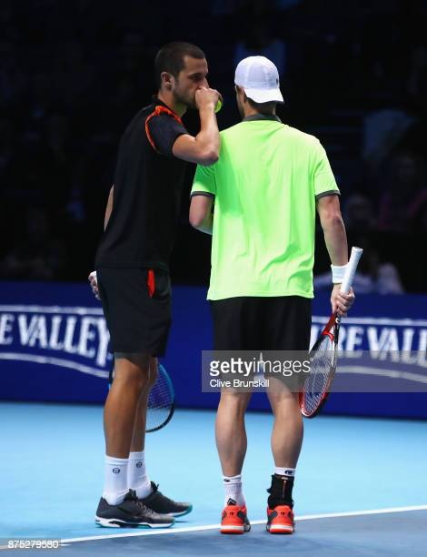 Mate Pavic of Croatia and Oliver Marach of Austria talk in their Doubles match against Bob and Mike Bryan of the United States during day six of the...