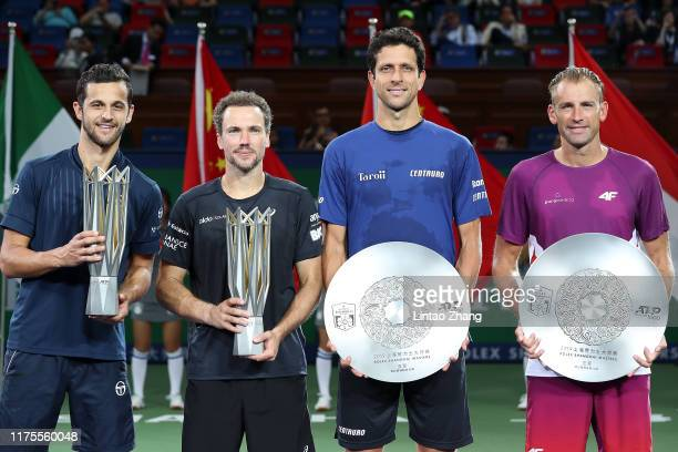 Mate Pavic of Croatia, Bruno Soares of Brazil, Marcelo Melo of Brazil and Lukasz Kubot of Poland celebrate with their trophy during the Award...