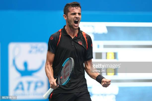 Mate Pavic of Croatia celebrates winning the match against Zihao Xia of China during Qualifying second round of 2017 ATP Chengdu Open at Sichuan...