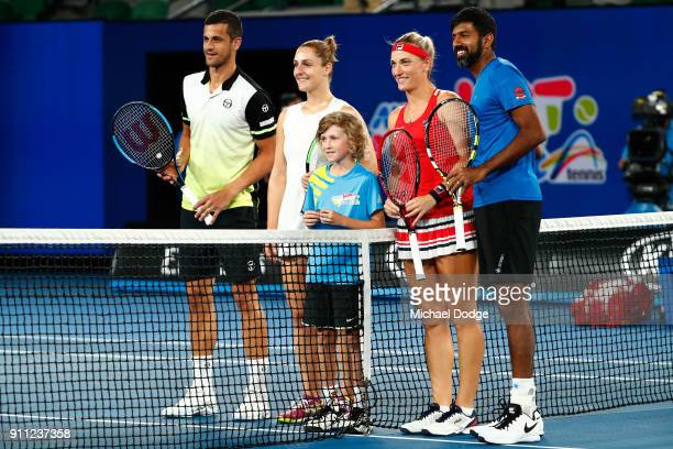 Mate Pavic of Croatia Gabriela Dabrowski of Canada Timea Babos of Hungary and Rohan Bopanna of India pose for a photo ahead of the mixed doubles...