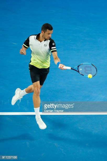 Mate Pavic of Croatia plays a forehand in the mixed doubles final with Gabriela Dabrowski of Canada against Rohan Bopanna of India and Timea Babos of...