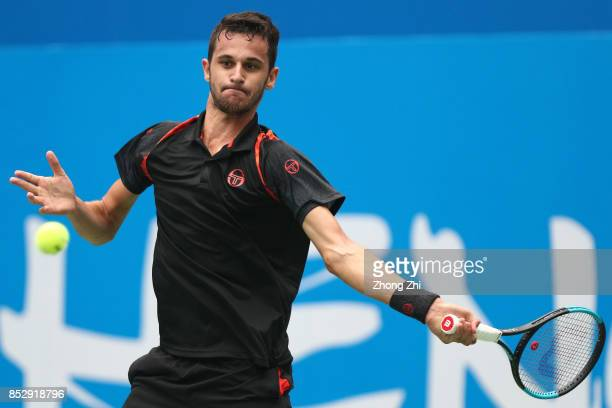 Mate Pavic of Croatia returns a shot during the match against Zihao Xia of China during Qualifying second round of 2017 ATP Chengdu Open at Sichuan...