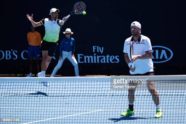 Mate Pavic of Croatia returns serve in his second round men's doubles match with Oliver Marach of Austria against Artem Sitak of New Zealand and...
