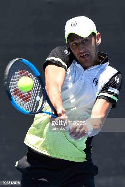 Mate Pavic of Croatia serves in his first round men's doubles match with Oliver Marach of Austria against Federico Delbonis of Argentina and Victor...