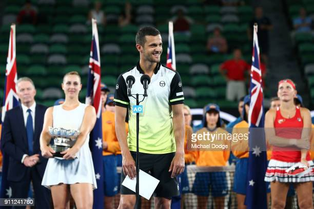 Mate Pavic of Croatia speaks at the trophy presentation after he and partner Gabriela Dabrowski of Canada won the mixed doubles final against Timea...