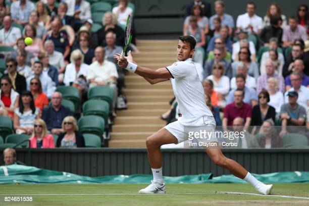 Mate Pavic of Croatian in action, along with Oliver Marach of Austria in the Men's Doubles Final on Center Court during the Wimbledon Lawn Tennis...