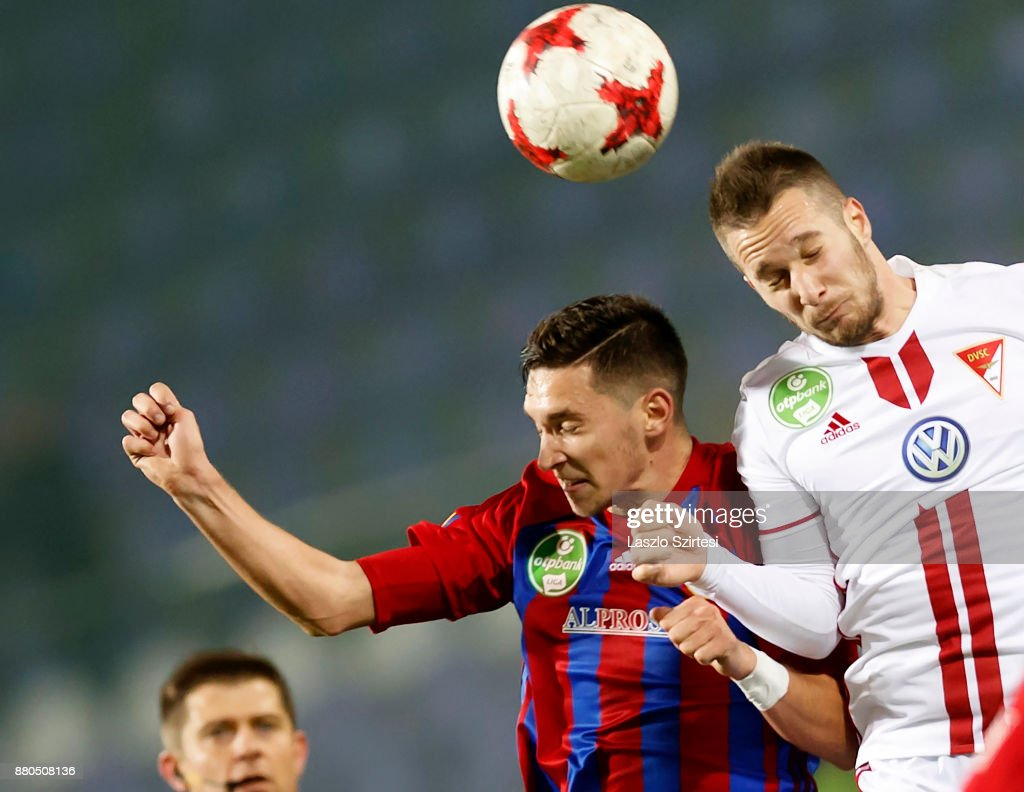 Mate Vida (L) of Vasas FC battles for the ball in the air with Adam Bodi (R) of DVSC during the Hungarian OTP Bank Liga match between Vasas FC and DVSC at Ferenc Szusza Stadium on November 25, 2017 in Budapest, Hungary.