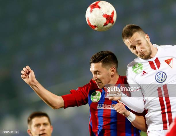 Mate Vida of Vasas FC battles for the ball in the air with Adam Bodi of DVSC during the Hungarian OTP Bank Liga match between Vasas FC and DVSC at...