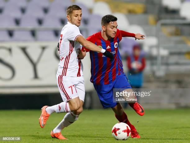 Mate Vida of Vasas FC fights for the ball with Aleksandar Jovanovic of DVSC during the Hungarian OTP Bank Liga match between Vasas FC and DVSC at...