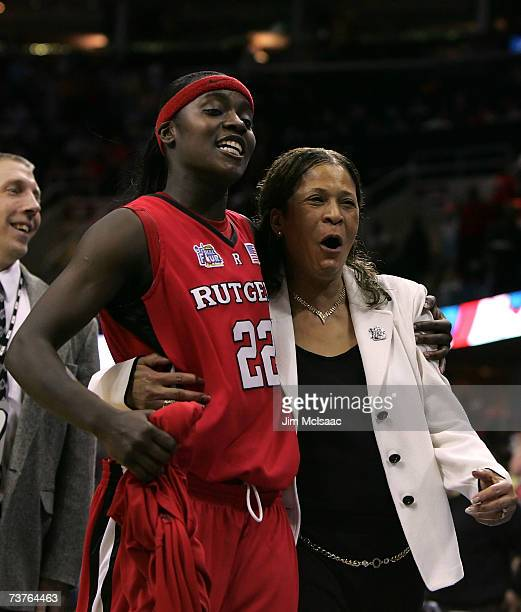 Matee Ajavon and head coach Vivian Stringer of the Rutgers Scarlet Knights celebrate after their 5935 win against the LSU Lady Tigers during the...