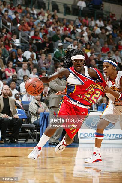Matee Ajavon of the East Girls drives around Sa'de WileyGatewood of the West Girls during the 2004 McDonald's High School AllAmerican Game at Ford...