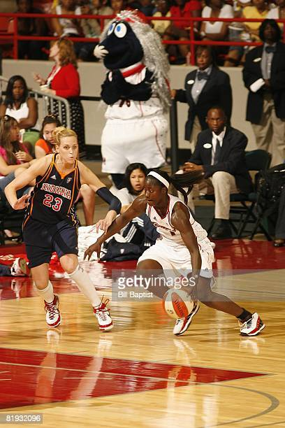 Matee Ajavon of the Houston Comets drives against Katie Douglas of the Indiana Fever during the game at Reliant Arena on June 28, 2008 in Houston,...