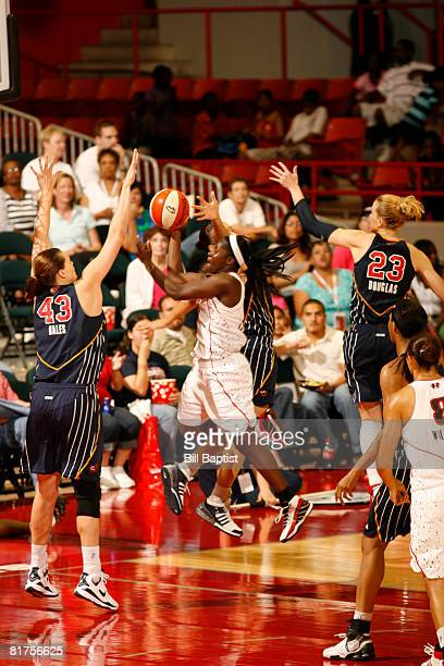 Matee Ajavon of the Houston Comets shoots the ball over Alison Bales of the Indiana Fever at Reliant Arena on June 28, 2008 in Houston, Texas. NOTE...