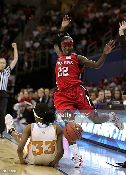 Matee Ajavon of the Rutgers Scarlet Knights loses the ball as she drives against Alberta Auguste of the Tennessee Lady Volunteers during the first...