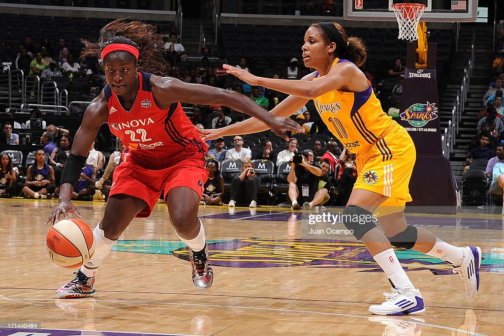 Matee Ajavon #22 of the Washington Mystics brings the ball up court against Lindsey Harding #10 of the Los Angeles Sparks at Staples Center on June 23, 2013 in Los Angeles, California.