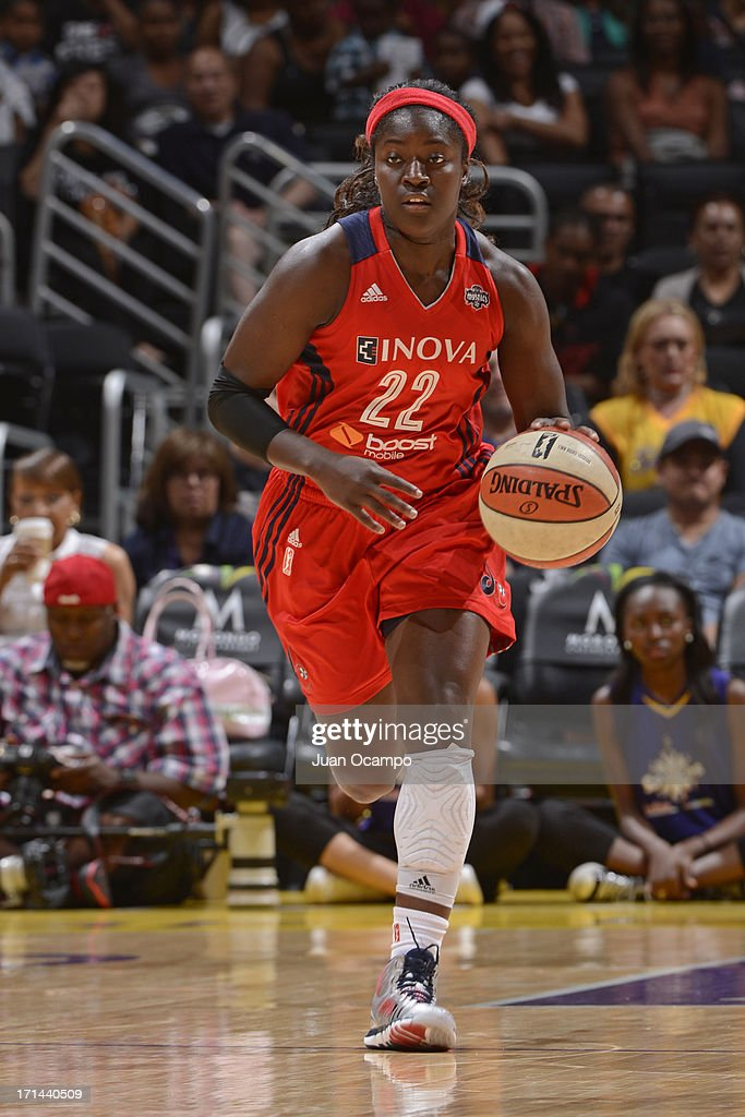 Matee Ajavon #22 of the Washington Mystics brings the ball up court against the Los Angeles Sparks at Staples Center on June 23, 2013 in Los Angeles, California.