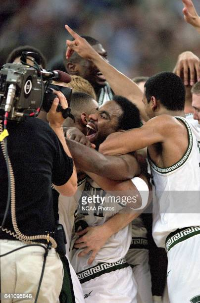 Mateen Cleaves and his Michigan St. Teammates celebrate their national championship as the final buzzer sounds during the NCAA Photos via Getty...